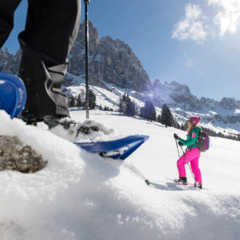 Snowshoe hiking on the Seiser Alm in the Dolomites